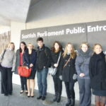 MSc students stand in front of the Scottish Parliament
